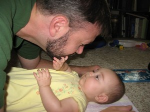 Father Looking Closely at Baby