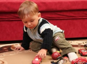 Toddler Playing with Cars on Floor