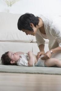 Woman Changing Diaper