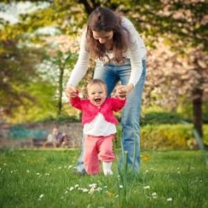 Adult Helping Toddler Walk