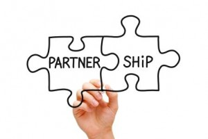 Two Puzzle Pieces That Spell Partnership