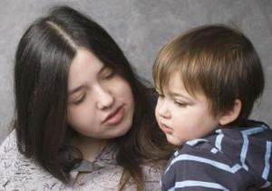 Woman Talking to Toddler