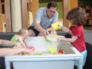 Adults and Toddlers Playing in Sandbox