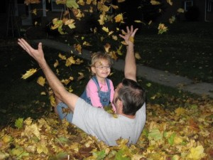 Father Daughter in Fall Leaves
