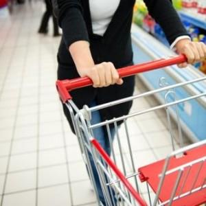 Woman pushing grocery cart